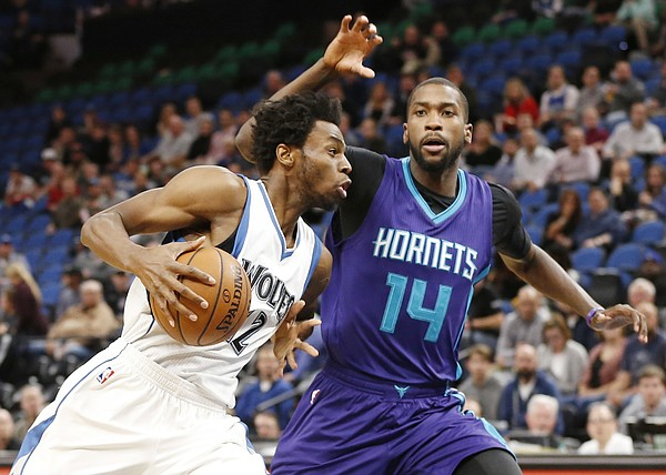 Minnesota Timberwolves' Andrew Wiggins, left, drives on Charlotte Hornets' Michael Kidd-Gilchrist in the first quarter of an NBA basketball game Tuesday, Nov. 15, 2016, in Minneapolis. (AP Photo/Jim Mone)