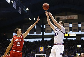 Kansas guard Sviatoslav Mykhailiuk (10) puts up a three from the corner over Nebraska forward Isaiah Roby (15) during the first half, Saturday, Dec. 10, 2016 at Allen Fieldhouse.