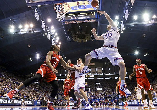 Kansas guard Sviatoslav Mykhailiuk (10) hooks a shot over Nebraska guard Evan Taylor (11) during the first half, Saturday, Dec. 10, 2016 at Allen Fieldhouse.