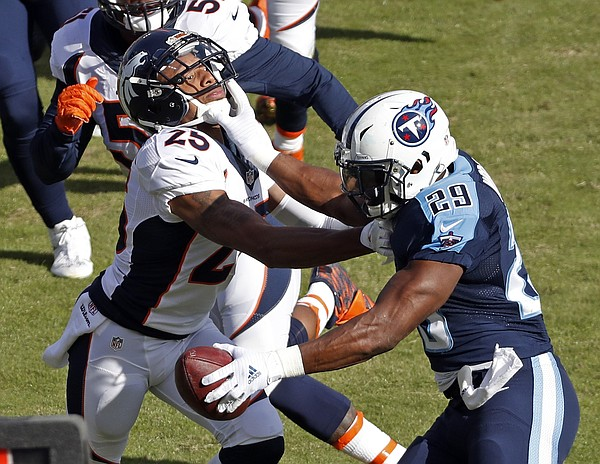 Tennessee Titans running back DeMarco Murray (29) pushes Denver Broncos cornerback Chris Harris (25) aside in the first half of an NFL football game Sunday, Dec. 11, 2016, in Nashville, Tenn. (AP Photo/Weston Kenney)