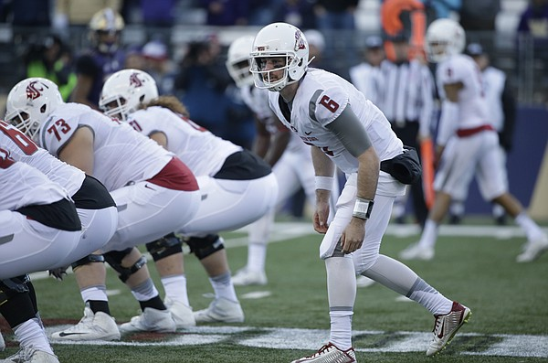 Washington State quarterback Peyton Bender in action in an NCAA college football game against Washington Friday, Nov. 27, 2015, in Seattle. Bender, who played his sophomore season at Itawamba Community College, signed Wednesday, Dec. 14, 2016, with Kansas football.  (AP Photo/Elaine Thompson)