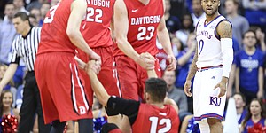 Kansas guard Frank Mason III (0) turns to an official after being whistled for a foul on Davidson guard Jack Gibbs (12) after Gibbs hit a three during the first half, Saturday, Dec. 17, 2016 at Sprint Center.