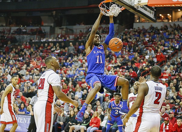 Kansas guard Josh Jackson (11) dunks against UNLV during the first half, Thursday, Dec. 22, 2016 at Thomas & Mack Center in Las Vegas.