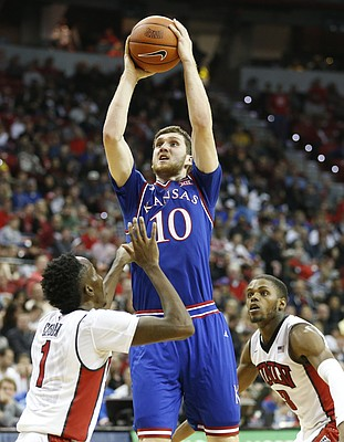 Kansas guard Sviatoslav Mykhailiuk (10) gets up for a bucket over UNLV guard Kris Clyburn (1) during the second half, Thursday, Dec. 22, 2016 at Thomas & Mack Center in Las Vegas. At right is UNLV forward Tyrell Green (3).