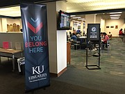 "University of Kansas Libraries ""You Belong Here"" marketing campaign, is aimed at attracting undergraduates and making sure they feel welcome, including those who are transgendered. This sign is posted inside Watson Library."