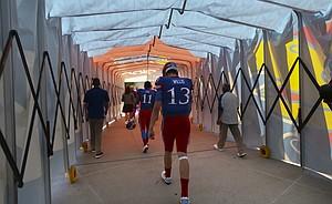 Kansas quarterback Ryan Willis (13) walks through the tunnel to the locker room following the Jayhawks' 24-23 heartbreaking loss to TCU on Saturday, Oct. 8, 2016 at Memorial Stadium.
