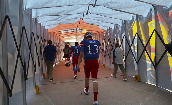 Kansas quarterback Ryan Willis (13) walks through the tunnel to the locker room following the Jayhawks' 24-23 heartbreaking loss to TCU on Saturday, Oct. 8, 2016 at Memorial Stadium.