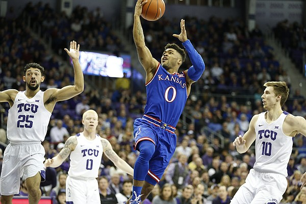 Kansas guard Frank Mason III (0) splits the TCU defense on his way to the bucket during the first half, Friday, Dec. 30, 2016 at Schollmaier Arena in Fort Worth, Texas