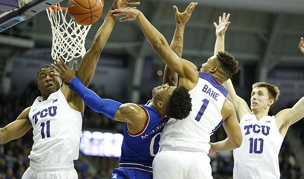 Kansas guard Frank Mason III (0) is fouled hard by TCU guard Desmond Bane (1) during the first half, Friday, Dec. 30, 2016 at Schollmaier Arena in Fort Worth, Texas