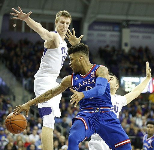 Kansas guard Frank Mason III (0) hooks a pass around TCU guard Michael Williams (2) and TCU forward Vladimir Brodziansky (10) during the first half, Friday, Dec. 30, 2016 at Schollmaier Arena in Fort Worth, Texas