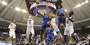 Kansas forward Landen Lucas (33) fights for a rebound inside during the second half against TCU, Friday, Dec. 30, 2016 at Schollmaier Arena in Fort Worth, Texas.