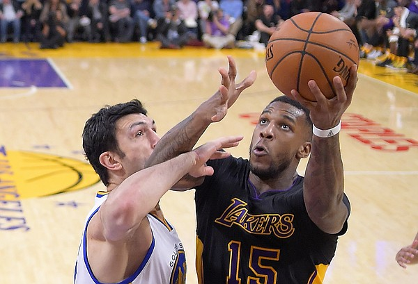 Los Angeles Lakers forward Thomas Robinson, right, shoots as Golden State Warriors center Zaza Pachulia, of the Republic of Georgia, defends during the second half of an NBA basketball game, Friday, Nov. 25, 2016, in Los Angeles. The Warriors won 109-85. (AP Photo/Mark J. Terrill)