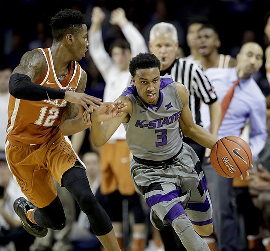 Kansas State's Kamau Stokes (3) is pressured by Texas' Kerwin Roach Jr. (12) during the second half of an NCAA college basketball game Friday, Dec. 30, 2016, in Manhattan, Kan. Kansas State won 65-62.