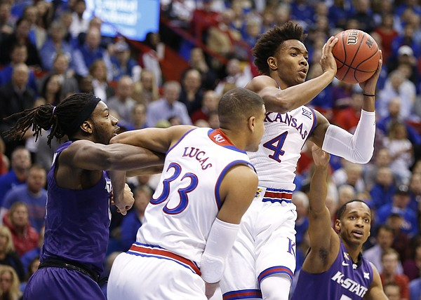 Kansas guard Devonte' Graham (4) look to pass during the first half, Tuesday, Jan. 3, 2017 at Allen Fieldhouse.