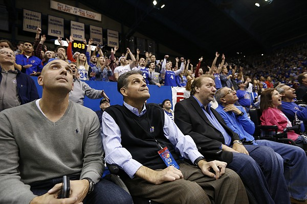 Scott Ward, University of Kansas associate athletic director for academic and career counseling, second from left,  watches as the starting lineups are introduced in his first game back after heart surgery on Tuesday, Jan. 3, 2017 at Allen Fieldhouse.