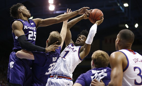 Kansas guard Josh Jackson (11) pulls a rebound from Kansas State forward Wesley Iwundu (25) and Kansas State forward Dean Wade (32) during the second half, Tuesday, Jan. 3, 2017 at Allen Fieldhouse.