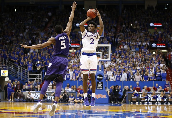 Kansas guard Lagerald Vick (2) puts up a three over Kansas State guard Barry Brown (5) during the second half, Tuesday, Jan. 3, 2017 at Allen Fieldhouse.