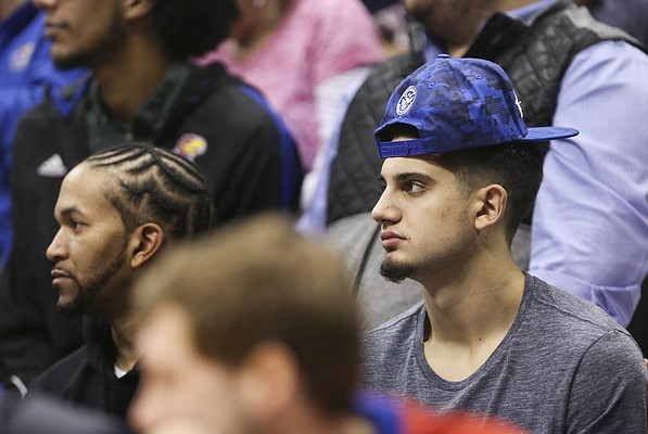 Arizona State transfer Sam Cunliffe, right, watches the action during the second half of Tuesday's game between the Jayhawks and Wildcats.