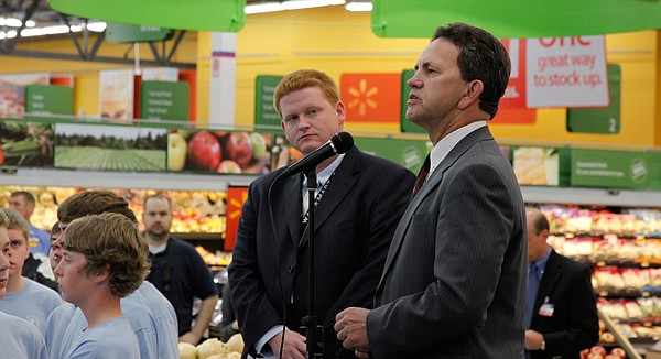 In this file photo from April 2009, Steve Kelly, right, speaks in his capacity as Kansas assistant secretary of commerce during the grand opening of the Lawrence Wal-Mart near Sixth Street and Wakarusa Drive. Kelly now serves as the vice president of economic development for the Lawrence chamber of commerce.