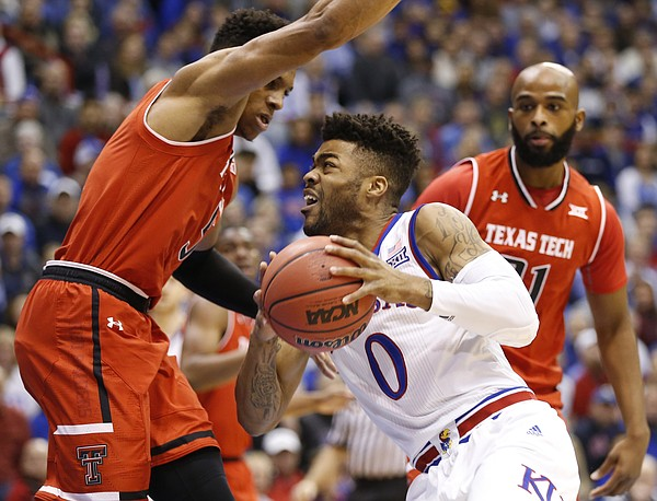 Kansas guard Frank Mason III (0) drives inside against Texas Tech forward Zach Smith (11) during the first half, Saturday, Jan. 7, 2017 at Allen Fieldhouse.
