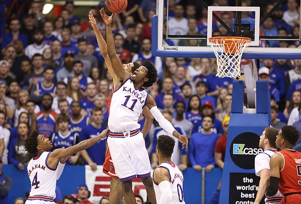 Kansas guard Josh Jackson (11) knocks a rebound away from Texas Tech forward Zach Smith during the second half, Saturday, Jan. 7, 2017 at Allen Fieldhouse.
