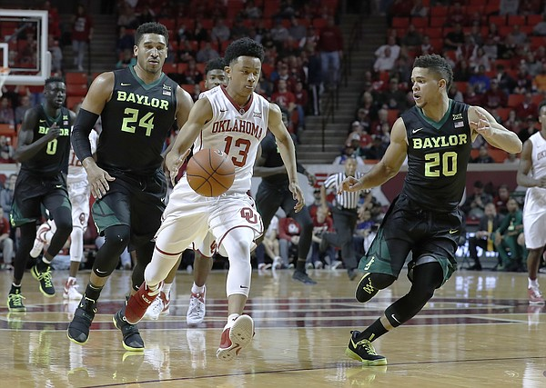 Oklahoma guard Jordan Shepherd (13) brings the ball up as Baylor guards Ishmail Wainright (24) and Manu Lecomte (20) defend during the second half of an NCAA college basketball game in Norman, Okla., on Friday, Dec. 30, 2016.