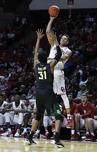 Oklahoma center Jamuni McNeace (4) shoots over Baylor forward Terry Maston (31) during the second half of an NCAA college basketball game in Norman, Okla., on Friday, Dec. 30, 2016. Baylor won 76-50.