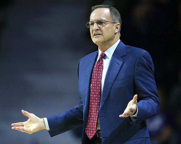 Oklahoma head coach Lon Kruger questions a call during the first half of an NCAA college basketball game against Kansas State in Manhattan, Kan., Saturday, Jan. 7, 2017.