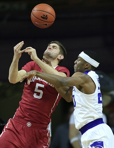 Oklahoma forward Matt Freeman (5) is stripped of the ball by Kansas State forward Xavier Sneed (20) during the first half of an NCAA college basketball game in Manhattan, Kan., Saturday, Jan. 7, 2017.