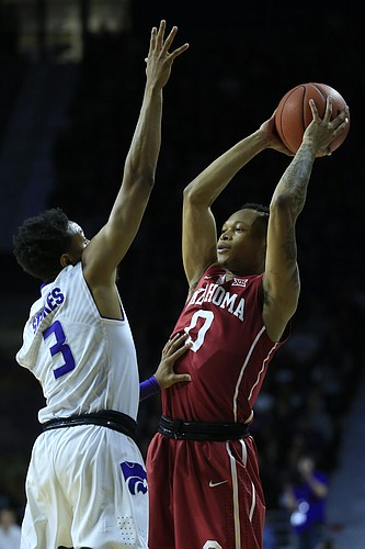 Oklahoma guard Darrion Strong-Moore (0) and Kansas State guard Kamau Stokes (3) during the first half of an NCAA college basketball game in Manhattan, Kan., Saturday, Jan. 7, 2017.