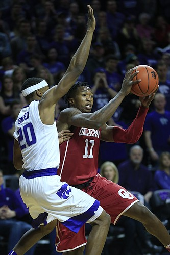 Oklahoma forward Kristian Doolittle (11) and Kansas State forward Xavier Sneed (20) during the first half of an NCAA college basketball game in Manhattan, Kan., Saturday, Jan. 7, 2017.