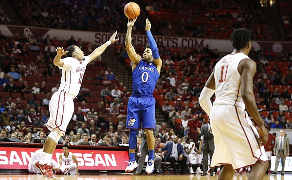Kansas guard Frank Mason III (0) puts up a three against Oklahoma guard Jordan Woodard (10) during the second half, Tuesday, Jan. 10, 2017 at Lloyd Noble Center in Norman, Okla.