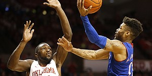 Kansas guard Frank Mason III (0) goes up to the bucket against Oklahoma forward Khadeem Lattin (12) during the second half, Tuesday, Jan. 10, 2017 at Lloyd Noble Center in Norman, Okla.