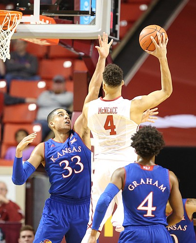 Kansas forward Landen Lucas (33) defends against a shot from Oklahoma center Jamuni McNeace (4) during the second half, Tuesday, Jan. 10, 2017 at Lloyd Noble Center in Norman, Okla.