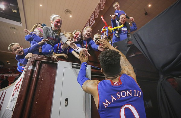 Kansas guard Frank Mason III (0) slaps hands with a gathering of Jayhawk fans following their 81-70 win over Oklahoma on Tuesday, Jan. 10, 2017 at Lloyd Noble Center in Norman, Okla.