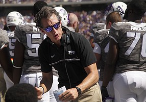 TCU co-offensive coordinator Doug Meacham talks to his players on the sideline in the second half of an NCAA college football game against Iowa State, Saturday, Sept. 17, 2016, in Fort Worth, Texas. TCU won 41-20.