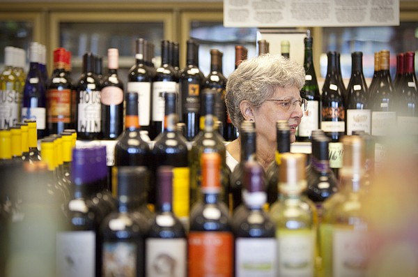 In this file photo from June 9, 2010, Lawrence resident Diane McFarland browses the wine selection at Myers Retail Liquor, 902 W. 23rd Street.