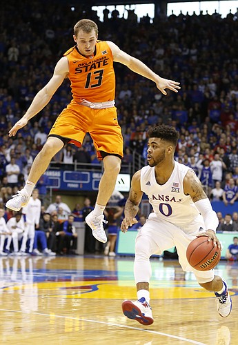 Kansas guard Frank Mason III (0) fakes Oklahoma State guard Phil Forte III (13) during the first half, Saturday, Jan. 14, 2017 at Allen Fieldhouse.