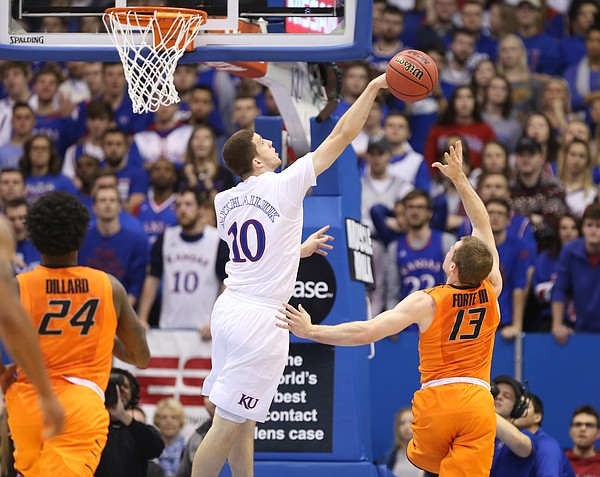 Kansas guard Sviatoslav Mykhailiuk (10) swats a shot by Oklahoma State guard Phil Forte III (13) during the first half, Saturday, Jan. 14, 2017 at Allen Fieldhouse.