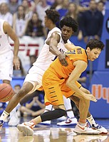Kansas guard Josh Jackson (11) knocks a ball loose from Oklahoma State guard Lindy Waters III (21) for a steal during the second half, Saturday, Jan. 14, 2017 at Allen Fieldhouse.