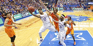 Kansas guard Frank Mason III (0) gets past Oklahoma State forward Mitchell Solomon (41) for a bucket during the second half, Saturday, Jan. 14, 2017 at Allen Fieldhouse.
