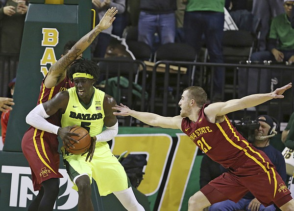 Baylor forward Johnathan Motley is guard by Iowa State guard Nick Weiler-Babb, left, and Iowa State guard Matt Thomas, right, while driving to the basket in the first half of an NCAA college basketball game, Wednesday, Jan. 4, 2017, in Waco, Texas.