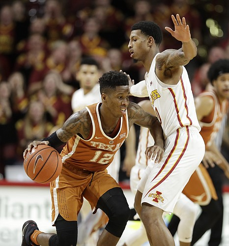 Texas guard Kerwin Roach Jr., left, drives past Iowa State forward Darrell Bowie, right, during the second half of an NCAA college basketball game, Saturday, Jan. 7, 2017, in Ames, Iowa.
