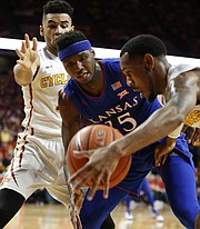 Kansas forward Carlton Bragg Jr. (15) vies for a loose ball with Iowa State guard Monte Morris, front, and Iowa State guard Nazareth Mitrou-Long during the first half, Monday, Jan. 16, 2017 at Hilton Coliseum.