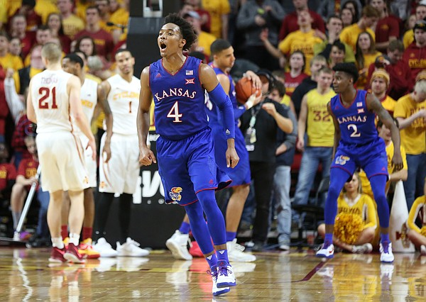 Kansas guard Devonte' Graham (4) celebrates as time expires in the Jayhawks' 76-72 win over Iowa State on Monday, Jan. 16, 2017 at Hilton Coliseum.