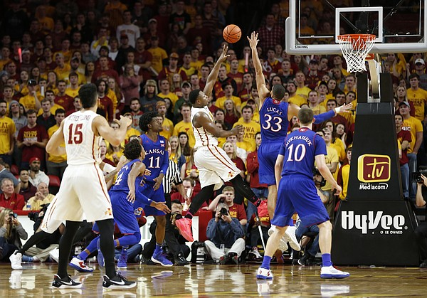Iowa State guard Deonte Burton turns for a shot over Kansas forward Landen Lucas (33) during the second half, Monday, Jan. 16, 2017 at Hilton Coliseum.