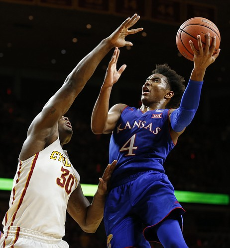 Kansas guard Devonte' Graham (4) gets in for a bucket against Iowa State guard Deonte Burton (30) during the second half, Monday, Jan. 16, 2017 at Hilton Coliseum.