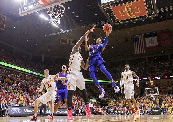 Kansas guard Devonte' Graham (4) gets to the bucket against Iowa State guard Deonte Burton (30) during the second half, Monday, Jan. 16, 2017 at Hilton Coliseum.