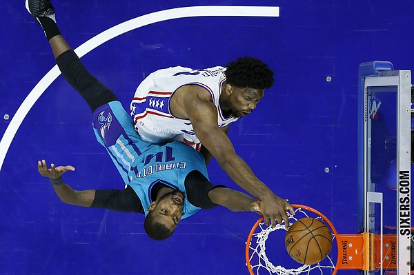Philadelphia 76ers' Joel Embiid, top, dunks against Charlotte Hornets' Michael Kidd-Gilchrist during the first half of an NBA basketball game, Friday, Jan. 13, 2017, in Philadelphia. (AP Photo/Matt Slocum)