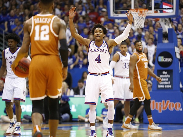 Kansas guard Devonte' Graham (4) raises up the Fieldhouse as Texas guard Kerwin Roach Jr. (12) brings up the ball during the first half, Saturday, Jan. 21, 2017.